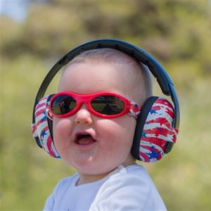 Baby with sound reducing headphones